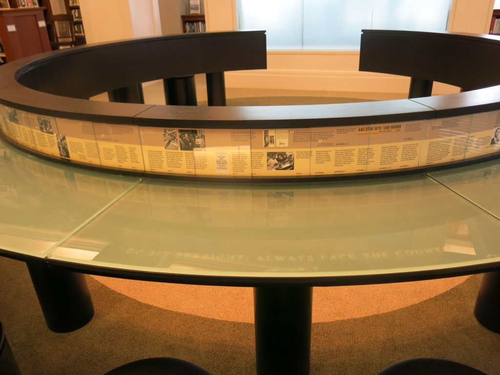 David felt instead of a normal reading table the table should represent something, so they turned it into a lunch counter- without the lunch.