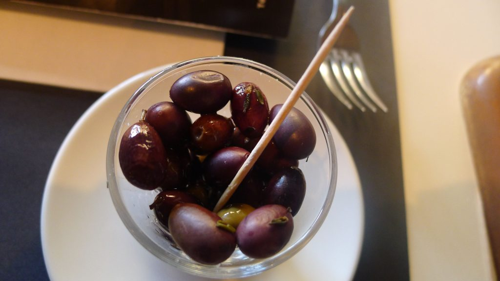 A little bowl of local olives on the table.
